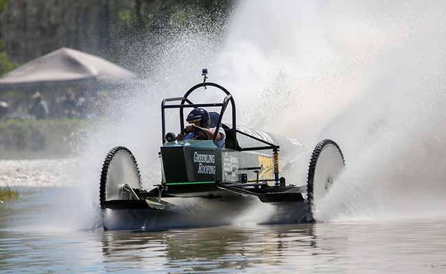 Dan Greenling behind the wheel on Roll On Greenling Roofing's Racing Team Swampbuggy Racing