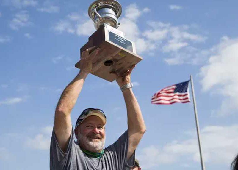 Dan Greenling hoisting 2019 Bud Cup trophy above head | Greenling Roofing, Inc. Swampbuggy Racing